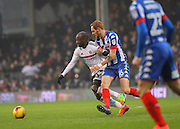 Sone Aluko fends off Shaun MacDonald during the EFL Sky Bet Championship match between Fulham and Wigan Athletic at Craven Cottage, London, England on 11 February 2017. Photo by Jack Beard.