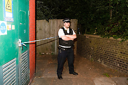 © Licensed to London News Pictures. 11/07/2019.<br /> Greenwich,UK Police officer at the back of Ethalion Lodge. A police officer standing near a garage area. A young man in his early 20s has been stabbed to death in Greenwich, South East London, Met police were called to the Shooters Hill area. A cordon is in place with police on guard. Photo credit: Grant Falvey/LNP