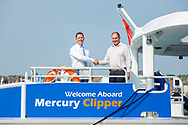 IMAGE PROVIDED FREE FOR EDITORIAL USE<br /> Sean Collins, CEO and co-founder of MBNA Thames Clippers (left) and Roy Whitewood, Senior Consultant at the Wight Shipyard Company pictured on board the newest addition to London&rsquo;s river bus transport network, Mercury Clipper, in East Cowes today as the vessel begins a 200 nautical mile maiden journey to the Capital from the Isle of Wight. Joining the MBNA Thames Clippers fleet, Mercury Clipper, is the first of two new boats that will enter service in London this summer. Six members of crew &ndash; with over 80 years of combined experience between them &ndash; will carry out the 12 hour journey, at an average speed of 20 knots. <br />  <br /> A &pound;6.3 million investment in London&rsquo;s port and transport infrastructure, Mercury Clipper and Jupiter Clipper have been built at the Wight Shipyard Co Ltd on the Isle of Wight. The boats took 10 months to build, creating over 75 new jobs across the Isle of Wight and London, including the hiring of two dedicated apprentices and engagement with over 100 local suppliers from across the South of England.<br />  <br /> For more information, please visit www.mbnathamesclippers.com<br /> Picture date: Wednesday June 21, 2017.<br /> Photograph by Christopher Ison &copy;<br /> 07544044177<br /> chris@christopherison.com<br /> www.christopherison.com