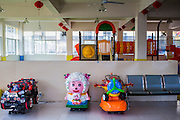 12 MARCH 2013 - ALONG HIGHWAY 13, LAOS:  The empty play area in the Chinese Sanetronic department store in Oudomaxy. The Chinese market in Oudomaxy is still under construction but much of the market is empty. Oudomaxy has a large Chinese immigrant community. By some estimates, as much as 40% of the people now living in the town are originally from China, most from the province Yunnan in southern China. The paving of Highway 13 from Vientiane to near the Chinese border has changed the way of life in rural Laos. Villagers near Luang Prabang used to have to take unreliable boats that took three hours round trip to get from the homes to the tourist center of Luang Prabang, now they take a 40 minute round trip bus ride. North of Luang Prabang, paving the highway has been an opportunity for China to use Laos as a transshipping point. Chinese merchandise now goes through Laos to Thailand where it's put on Thai trains and taken to the deep water port east of Bangkok. The Chinese have also expanded their economic empire into Laos. Chinese hotels and businesses are common in northern Laos and in some cities, like Oudomxay, are now up to 40% percent. As the roads are paved, more people move away from their traditional homes in the mountains of Laos and crowd the side of the road living off tourists' and truck drivers.    PHOTO BY JACK KURTZ