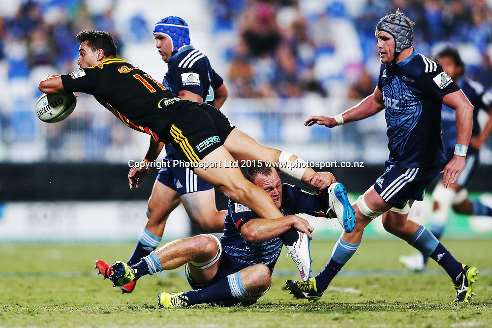 James Lowe of the Chiefs offloads in the tackle from Luke Braid of the Blues. Super Rugby match, Blues v Chiefs at QBE Stadium, Auckland, New Zealand. Saturday 14 February 2015. Photo: Anthony Au-Yeung / www.photosport.co.nz