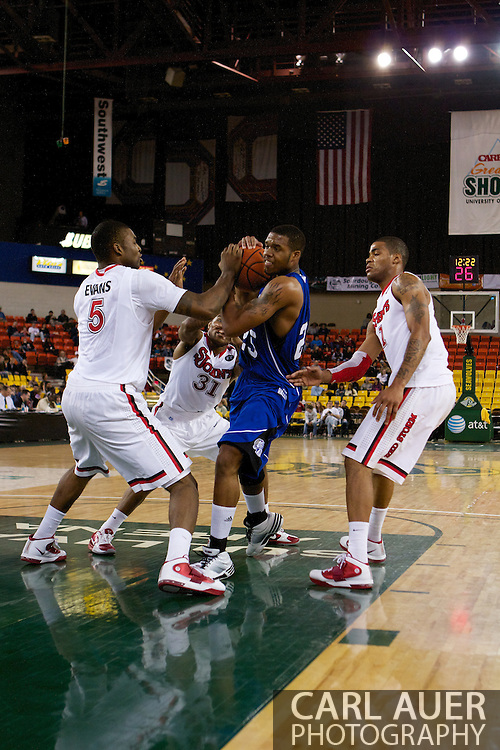 November 26th, 2010:  Anchorage, Alaska - Drake Bulldog freshman guard David Smith (25) fights his way into the lane in the Bulldog's loss to St. Johns at the Great Alaska Shootout.  The Red Storm defense held Drake to a tournament low score as St. Johns advanced to the final game 82-39.
