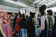 People at train station in Clacton on sea, Essex, UK, 1980s