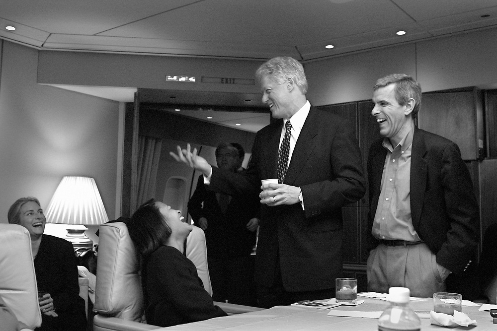 Former President Clinton jokes on Air Force One (now called Special Mission 28000 for this trip) on the flight from DC to NY after the Inaugural.  Friend and advisor Bruce Lindsey is to the right.