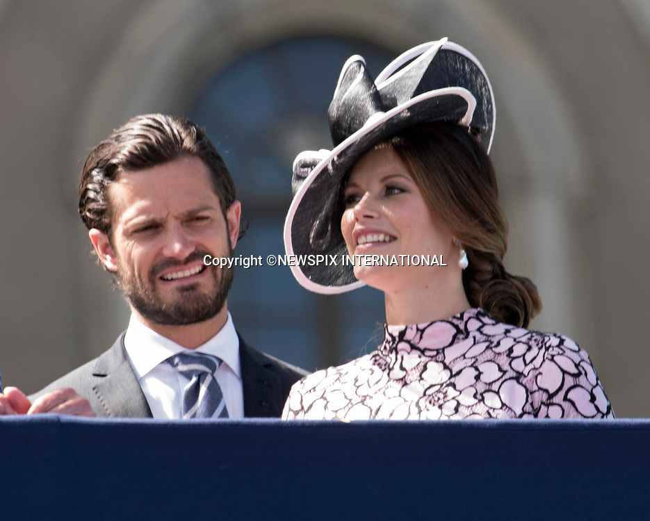 14.07.2017; Stockholm Sweden: PRINCE ACRL PHILIP AND PRINCESS SOFIA<br /> observe the carriage procession around the city of Stockholm on the occasion of Crown Princess Victoria&rsquo;s 40th Birthday, from the balocny of the royl Palace.<br /> King Carl Gustaf, Queen Silvia, Princess Madeleine, Christopher, Prince Carl Philip and Princess Sofia cheered the Crown Princess as the carriage passed the Royal Palace balcony.<br /> Mandatory Photo Credit: &copy;Francis Dias/NEWSPIX INTERNATIONAL<br /> <br /> IMMEDIATE CONFIRMATION OF USAGE REQUIRED:<br /> Newspix International, 31 Chinnery Hill, Bishop's Stortford, ENGLAND CM23 3PS<br /> Tel:+441279 324672  ; Fax: +441279656877<br /> Mobile:  07775681153<br /> e-mail: info@newspixinternational.co.uk<br /> Usage Implies Acceptance of Our Terms &amp; Conditions<br /> Please refer to usage terms. All Fees Payable To Newspix International