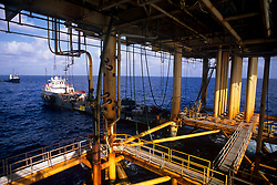Stock photo of an underside of a jack up rig with an oil tanker