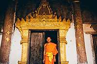 A portrait of a novice monk in Luang Prabang.