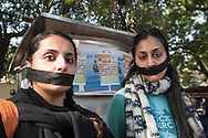 29th Dec. 2012. Two self-imposed gagged women take part in a demonstration in the Jantar Mantar area of New Delhi in reaction to the gang-rape of a young medical student in the Indian capital. Earlier that day news broke that the victim had died of her injuries.