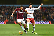 Nottingham Forest defender Tobias Figueiredo (3) tackles Aston Villa defender Ahmed Elmohamady (27) during the EFL Sky Bet Championship match between Aston Villa and Nottingham Forest at Villa Park, Birmingham, England on 28 November 2018.