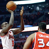 10 May 2011: Chicago Bulls small forward Luol Deng (9) takes a jumpshot over Atlanta Hawks center Jason Collins during the Chicago Bulls 95-83 victory over the Atlanta Hawks, during game 5 of the Eastern Conference semi finals at the United Center, Chicago, Illinois, USA.
