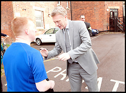 New Manchester Utd manager David Moyes signs an Everton fans shirt after arriving at the Cambridge Union debating society to give a talk on leadership, UK. May 13 2013.Photo by: Matthew Power / i-Images.<br />
