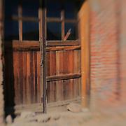 Wood Doors Decaying Brick Building - Bodie, CA - Lensbaby