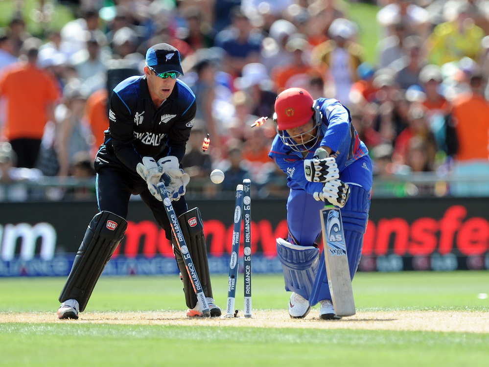Afghanistan's Usman Ghani bowled for 0 by New Zealand's Daniel Vettori in front of Luke Ronchi in the ICC Cricket World Cup at McLean Park, Napier, New Zealand, Sunday, March 08, 2015. Credit:SNPA / Ross Setford
