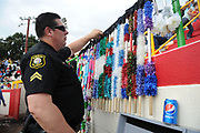 BEA AHBECK/NEWS-SENTINEL<br /> San Joaquin Sheeriff's deputy Jeff Lucks checks the velcro-tipped 'spears' which are used during the bloodless bullfight during the Our Lady of Fatima Portuguese Festival in Thornton Saturday, Oct. 15, 2016.