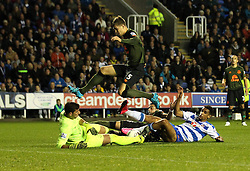 Nick Blackman of Reading FC slides in on Joel Robles of Everton as John Stones of Everton jumps over - Mandatory byline: Robbie Stephenson/JMP - 07966 386802 - 22/09/2015 - FOOTBALL - Madejski Stadium - Reading, England - Reading v Everton - Capital One Cup