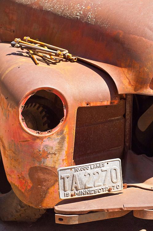 Old rusty car with 1970 Minnesota plates, Minnesota, USA