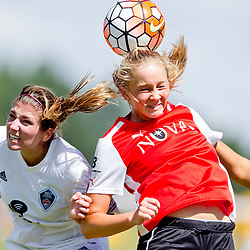 FC Nova 97/98 U18 girls soccer player Aubree Chatterton (right, 24) wins a header over against Rio Rapids 98 player Jordyn Lacy (left, 4) during the quarterfinals of the Far West Championships at Simplot Field in Boise, Idaho. FC Nova 97/98 defeated Rio Rapids 98 4-1. Friday June 24, 2016