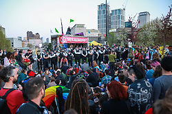 London, UK. 20th April 2019. Large numbers of police officers stand around the stage used by climate change campaigners from Extinction Rebellion on Waterloo bridge as part of an operation to try to clear the bridge of activists and visitors. The bridge has now been blocked throughout the six days of the International Rebellion called by Extinction Rebellion to demand urgent action to combat climate change by the British government.