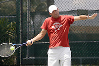 Colombian Tennis former champion, Miguel Tobon, returns the ball to one of his students during a training session at Pembroke Lakes Tennis Club on Tuesday June 16, 2009. Staff photo/Cristobal Herrera .....
