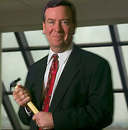 "9/21/06 Omaha NE  Managing Director of Finance for TD Ameritrade Bill Gerber in the lobby of  TD Ameritrade corporate headquarters in Omaha, Neb Thursday morning with his symbolic hammer, that he uses to ""hammer out"" budgets..(Chris Machian/for Financial Week)"
