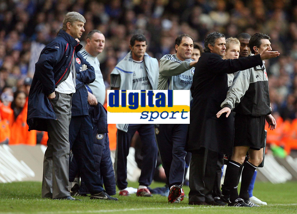 Photo: Rich Eaton.<br /> <br /> Chelsea v Arsenal. Carling Cup Final. 25/02/2007. Jose Mourinho, manager of Chelsea and Arsene Wenger look on as their players brawl during the second half