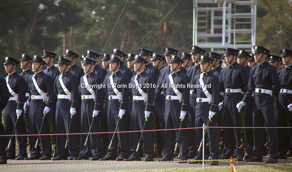 October, 23, 2016, Asaka, Saitama Prefecture, Japan: Cadets from the National Defense Academy, Japan's version of West Point, march in full regalia during the annual military review held at the Asaka Training Area, a Japan Ground Self Defense Force (JSDF) base on the outskirts of Tokyo. For this event, Prime Minister Shinzo Abe, top ranking Japanese brass and international dignitaries were in attendance to view Japan's military might. This included 4000 troops, 27 divisions, 280 vehicles and artillery, plus 50 aircraft of the Ground, Air, and Maritime branches of the JSDF. (Torin Boyd/Polaris).