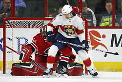 November 7, 2017 - Raleigh, NC, USA - The Carolina Hurricanes' Scott Darling (33) defends the net against the Florida Panthers' Jonathan Huberdeau (11) during the first period at PNC Arena in Raleigh, N.C., on Tuesday, Nov. 7, 2017. (Credit Image: © Chris Seward/TNS via ZUMA Wire)