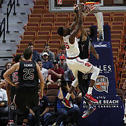 Yankuba Sima, (left), St. John's, slam dunks over Chris Silva, South Carolina, during the St. John's vs South Carolina Men's College Basketball game in the Hall of Fame Shootout Tournament at Mohegan Sun Arena, Uncasville, Connecticut, USA. 22nd December 2015. Photo Tim Clayton