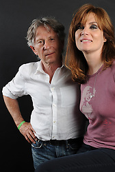 Roman Polanski and his wife Emmanuelle Seigner posing during a photo session as part of the Montreux Jazz Festival in Montreux, Switzerland on July 17, 2010. Polanski, freed this week after Switzerland refused a US extradition request, said Saturday he felt warm affection for the country despite his arrest last year. The 76-year-old director, came to see his wife Emmanuelle Seigner perform at the Montreaux Jazz Festival. Photo by Loona/ABACAPRESS.COM