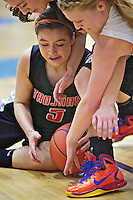 Whitney Gonzales from Post Falls High tries to secure a loose ball as her teammate Katie King leans over her and Lewiston High's Karlee Wilson attempts to knock the ball away in the second half.