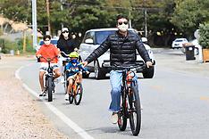 Simon Cowell and Lauren Silverman sport masks during bike ride - 5 April 2020