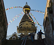 "A long stairway ascends to Buddhist Swayambhunath, the ""Monkey Temple"", which was founded about 500 AD, one of the oldest and holiest Buddhist sites in the Kathmandu Valley. It sits on a hill in the west of Kathmandu overlooking the city in Nepal, Asia."