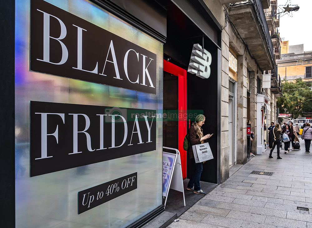 November 22, 2018 - Barcelona, Catalonia, Spain - A commercial poster offering discounts on Black Friday is seen in one of the shops in the center of Barcelona..The commercial campaign of Black Friday sales starts in Barcelona. The main shops of the city offer discounts between 10% and 40% if the purchase takes place during this week, mainly on Friday 23. (Credit Image: © Paco Freire/SOPA Images via ZUMA Wire)
