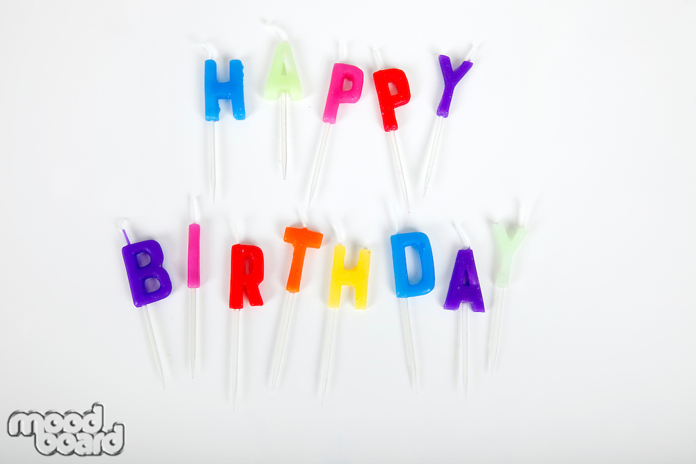 Birthday candles against white background