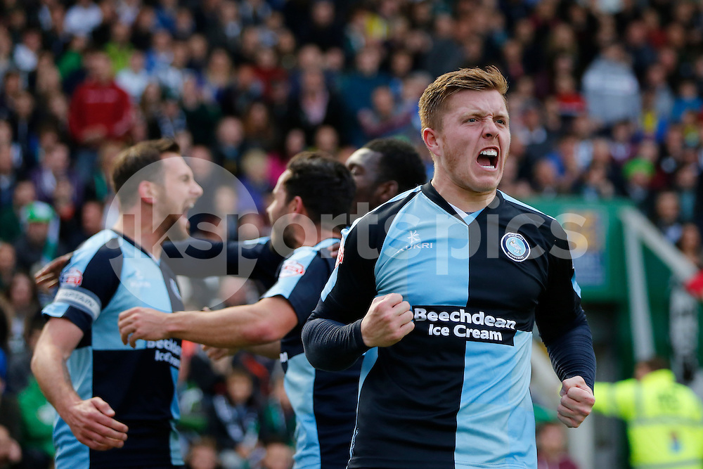 Alfie Mawson celebrate's his side's first goal during the Sky Bet League 2 Play Off 1st Leg match between Plymouth Argyle and Wycombe Wanderers at Home Park, Plymouth, England on 9 May 2015. Photo by Mark Hawkins.