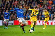Borna Barisic (#31) of Rangers FC passes the ball just before he is tackled by Mateus Uribe (#16) of FC Porto during the Group G Europa League match between Rangers FC and FC Porto at Ibrox Stadium, Glasgow, Scotland on 7 November 2019.