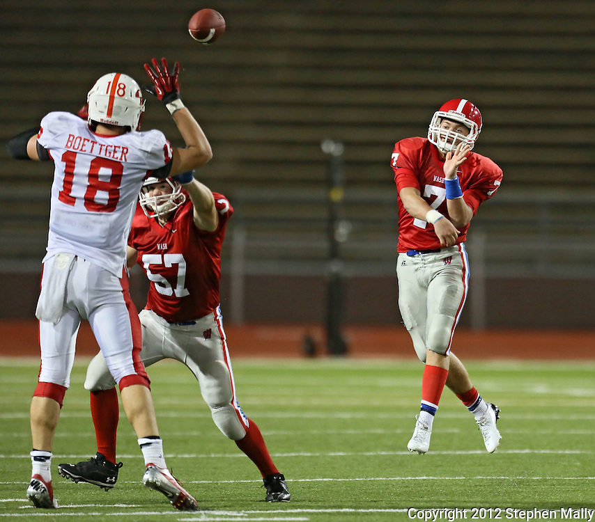Cedar Falls' Ike Boettger (18) gets his hands up to block a pass by Washington's Mitch Blades (7) as Noah Fox (57) tries to block during the game between Cedar Falls and Cedar Rapids Washington at Kingston Stadium in Cedar Rapids on Friday, September 7, 2012.