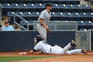 Ole Miss' Austin Anderson (8) is safe at third as Arkansas-Pine Bluff's Tyler Oertle (12) awaits the throw at Oxford-University Stadium in Oxford, Miss. on Wednesday, April 2, 2014.