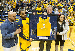 Nov 23, 2015; Morgantown, WV, USA; West Virginia Mountaineers guard Jaysean Paige (5) poses with West Virginia Mountaineers head coach Bob Huggins before their game against the Texas Tech Red Raiders at WVU Coliseum. Mandatory Credit: Ben Queen-USA TODAY Sports