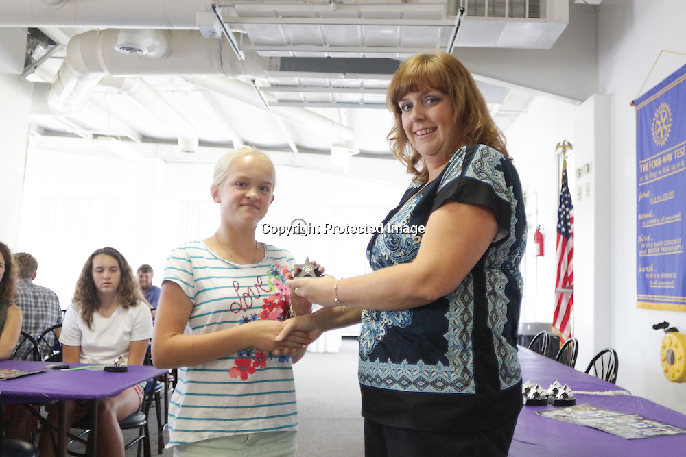 Riley Perdue accepts an award from Star News Editor Sherry Jones for the 15 Under 15 project Sunday September 14, 2014 at Jungle Rapids in Wilmington, N.C. (Jason A. Frizzelle)