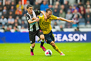Nacho Monreal (#18) of Arsenal FC and Miguel Almiron (#24) of Newcastle United FC tussle for the ball during the Premier League match between Newcastle United and Arsenal at St. James's Park, Newcastle, England on 11 August 2019.
