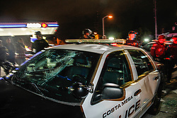 Anti Trump supporters destroy a police car during Donald Trump for President rally in Costa Mesa, CA at the OC Fair & Event Center - The Pacific Amphitheater. Thursday, April 28, 2016