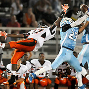 A pass intended for New Hanover's 17 is intercepted by South Florence defenders during the Carolinas Clash Kickoff Saturday August 30, 2014 in Myrtle Beach, S.C. (Jason A. Frizzelle)