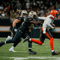 Sep 16, 2018; New Orleans, LA, USA; Cleveland Browns quarterback Tyrod Taylor (5) stiff arms New Orleans Saints linebacker Demario Davis (56) during the fourth quarter of a game at the Mercedes-Benz Superdome. The Saints defeated the Browns 21-18. Mandatory Credit: Derick E. Hingle-USA TODAY Sports