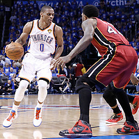 12 June 2012: Oklahoma City Thunder point guard Russell Westbrook (0) looks to pass the ball during the second half of Game 1 of the 2012 NBA Finals between the Heat and the Thunder, at the Chesapeake Energy Arena, Oklahoma City, Oklahoma, USA.