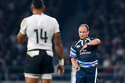 Referee Jaco Peyper (South Africa) gestures after a possible tip tackle from Fiji - Mandatory byline: Rogan Thomson/JMP - 07966 386802 - 18/09/2015 - RUGBY UNION - Twickenham Stadium - London, England - England v Fiji - Rugby World Cup 2015 Pool A.