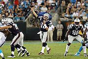 On his first play of the night, New England Patriots quarterback Tom Brady (12) throws a completed pass for a gain of 37 yards to New England Patriots wide receiver Aaron Dobson (17) good for a first down at the Carolina Panthers 12 yard line during the 2016 NFL preseason football game against the Carolina Panthers on Friday, Aug. 26, 2016 in Charlotte, N.C. The Patriots won the game 19-17. (©Paul Anthony Spinelli)