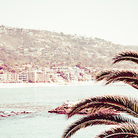 Laguna Beach California retro panorama photo. Panoramic photo ratio is 1:3 and has a vintage 1970s retro tone. Laguna Beach is a popular coastal town in Orange County Southern California.