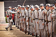 Confederate troops stand for inspection at Fort Sumter on the 150th anniversary of the surrender of the fort in the US Civil War on April 14, 2011 in Charleston, South Carolina.  The surrender of the fort marks the end of a week long commemoration of the start of the Civil War.