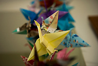 Hand made arigami birds made by members of the Congregational Church of Laconia were received and hang as a mobile at Temple B'nai Israel to express their support, encouragement and hope. (Karen Bobotas/for the Laconia Daily Sun)